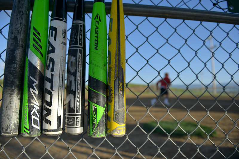 Justin Sheely | The Sheridan Press<br /> Bats hang in a dugout during the Sheridan Recreation District's Adult League Softball Wednesday night at the Sheridan College Campus.