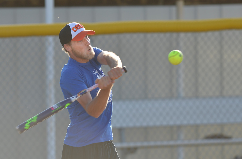Justin Sheely | The Sheridan Press<br /> Cas Brewer swings at the ball during the Sheridan Recreation District's Adult League Softball Wednesday night at the Sheridan College Campus.