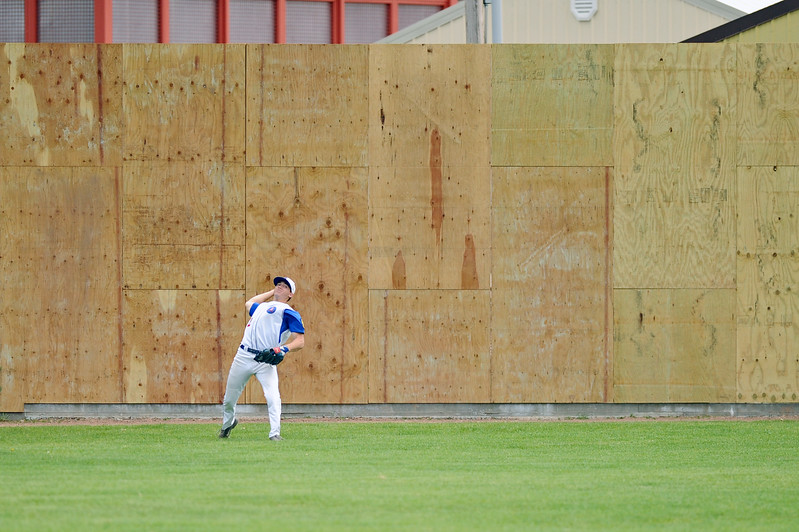 Coy Steel makes a long throw from center field on Sunday, May 7 at Thorne-Rider Stadium. The American Legion is in the process of renovating numerous aspects of the stadium, including the wall in center field. Mike Pruden | The Sheridan Press