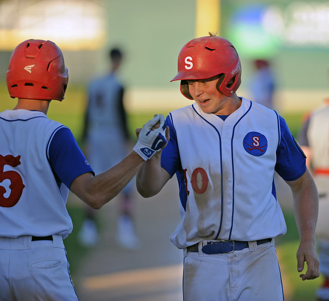 Nolan McCafferty gets a high five as he scores a run early in Sheridan's game againt Casper on Wednesday, May 10 at Thorne-Rider Stadium. Mike Pruden | The Sheridan Press