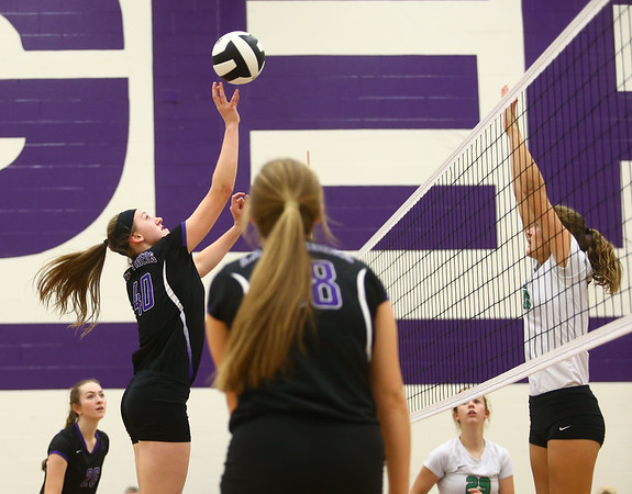 8-29-17<br /> Northwestern vs. Clinton Central volleyball<br /> Steph Burns taps the ball over the net.<br /> Kelly Lafferty Gerber | Kokomo Tribune