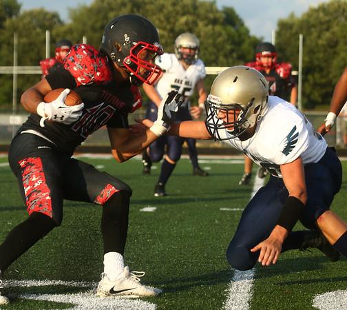 8-11-17<br /> Taylor vs Oak Hill football scrimmage<br /> Peyton Johnson runs the ball.<br /> Kelly Lafferty Gerber | Kokomo Tribune