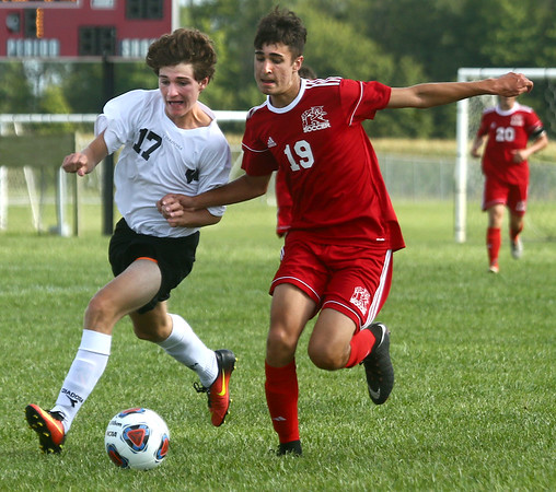 8-17-17<br /> Western vs Kokomo boys soccer<br /> Western's Collin Rassel, left, and Kokomo's Alec Barreira.<br /> Kelly Lafferty Gerber   Kokomo Tribune