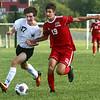 8-17-17<br /> Western vs Kokomo boys soccer<br /> Western's Collin Rassel, left, and Kokomo's Alec Barreira.<br /> Kelly Lafferty Gerber | Kokomo Tribune
