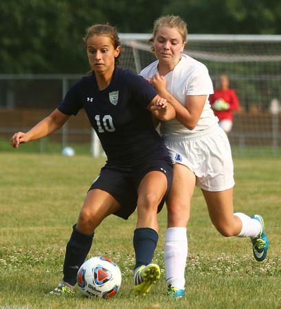 8-16-17<br /> Kokomo vs Oak Hill girls soccer<br /> Kokomo's Katherine Lay and Oak Hill's Olivia Smith battle for control of the ball.<br /> Kelly Lafferty Gerber   Kokomo Tribune