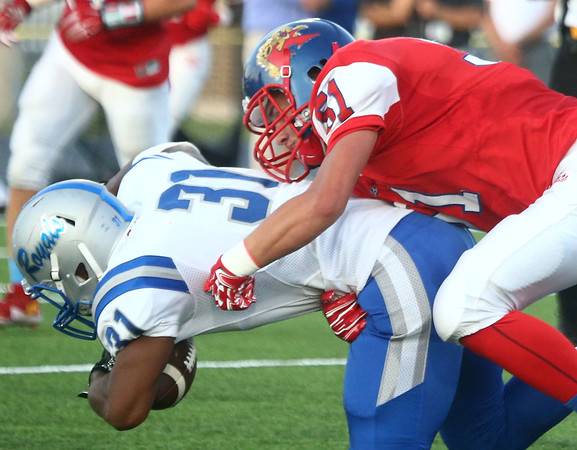 8-18-17<br /> Kokomo vs Hamilton SE football<br /> Kokomo's James Bufkin takes down Hamilton SE's Lance Stephens.<br /> Kelly Lafferty Gerber | Kokomo Tribune