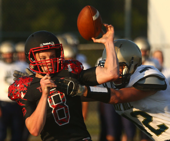 8-11-17<br /> Taylor vs Oak Hill football scrimmage<br /> Clay Brubaker attempts a pass.<br /> Kelly Lafferty Gerber | Kokomo Tribune
