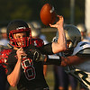 8-11-17<br /> Taylor vs Oak Hill football scrimmage<br /> Clay Brubaker attempts a pass.<br /> Kelly Lafferty Gerber | Kokomo Tribune