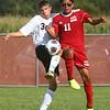 8-17-17<br /> Western vs Kokomo boys soccer<br /> Western's #3 and Kokomo's Quincy Armstrong go after the ball.<br /> Kelly Lafferty Gerber | Kokomo Tribune