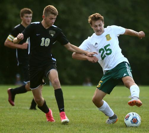 8-30-17<br /> Eastern vs Peru boys soccer<br /> Eastern's Joe Hawes and Peru's Logan Stanfield go after the ball.<br /> Kelly Lafferty Gerber | Kokomo Tribune