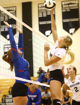 8-15-17<br /> Western vs Kokomo volleyball<br /> Western's Hannah Merica knocks it over the net.<br /> Kelly Lafferty Gerber | Kokomo Tribune