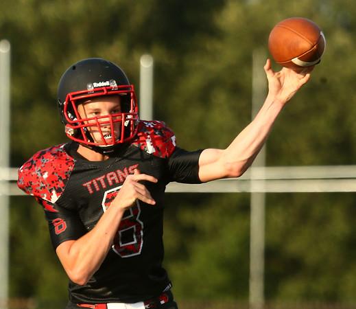 8-11-17<br /> Taylor vs Oak Hill football scrimmage<br /> Clay Brubaker throws a pass.<br /> Kelly Lafferty Gerber | Kokomo Tribune