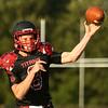 8-11-17<br /> Taylor vs Oak Hill football scrimmage<br /> Clay Brubaker throws a pass.<br /> Kelly Lafferty Gerber   Kokomo Tribune