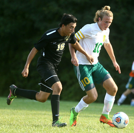 8-30-17<br /> Eastern vs Peru boys soccer<br /> Eastern's Lance VanMatre and Peru's Justin Yoo go after the ball.<br /> Kelly Lafferty Gerber | Kokomo Tribune