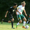8-30-17<br /> Eastern vs Peru boys soccer<br /> Eastern's Lance VanMatre and Peru's Justin Yoo go after the ball.<br /> Kelly Lafferty Gerber   Kokomo Tribune