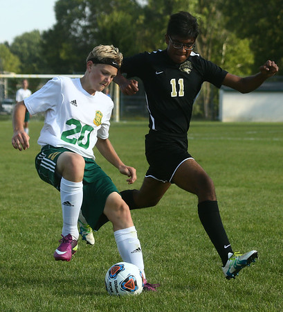 8-30-17<br /> Eastern vs Peru boys soccer<br /> Eastern's Evan Spell and Peru's Adhir Patel go after the ball.<br /> Kelly Lafferty Gerber | Kokomo Tribune