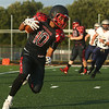 8-11-17<br /> Taylor vs Oak Hill football scrimmage<br /> Peyton Johnson runs the ball.<br /> Kelly Lafferty Gerber   Kokomo Tribune