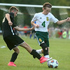 8-30-17<br /> Eastern vs Peru boys soccer<br /> Jared Smith takes control of the ball.<br /> Kelly Lafferty Gerber | Kokomo Tribune