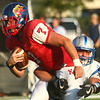 8-18-17<br /> Kokomo vs Hamilton SE football<br /> Kyle Wade tries to outrun Hamilton SE's defense.<br /> Kelly Lafferty Gerber | Kokomo Tribune