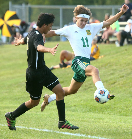 8-30-17<br /> Eastern vs Peru boys soccer<br /> Aren Turner tries to keep the ball from going out of bounds.<br /> Kelly Lafferty Gerber | Kokomo Tribune