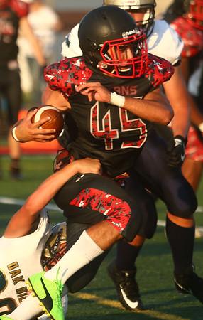 8-11-17<br /> Taylor vs Oak Hill football scrimmage<br /> Anthony Townsend runs the ball.<br /> Kelly Lafferty Gerber   Kokomo Tribune