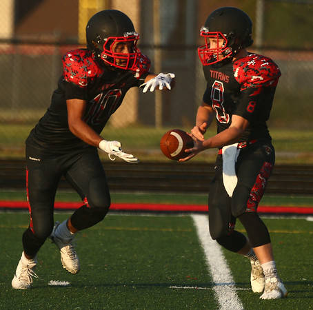 8-11-17<br /> Taylor vs Oak Hill football scrimmage<br /> Clay Brubaker tosses to Peyton Johnson.<br /> Kelly Lafferty Gerber | Kokomo Tribune