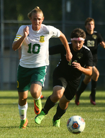 8-30-17<br /> Eastern vs Peru boys soccer<br /> Eastern's Lance VanMatre and Peru's Mathew Snyder go after the ball.<br /> Kelly Lafferty Gerber | Kokomo Tribune