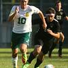 8-30-17<br /> Eastern vs Peru boys soccer<br /> Eastern's Lance VanMatre and Peru's Mathew Snyder go after the ball.<br /> Kelly Lafferty Gerber   Kokomo Tribune