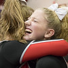 Sophmore Madison Swisher hugs teammate Grace Rogers  and is overcome with joy after winning the meet