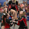 Madison Swisher prepares to be propelled by her stunt group