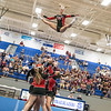 Carlee Huffman is tossed in to the air by her stunt group.