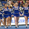 Spotswood Cheerleaders take the mat hand and hand together
