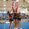 Carlee Huffman holds up a sign during East Rocks cheer portion of their routine