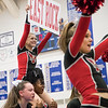 Savannah Baugher holds up a sign during East Rocks cheer portion of their routine