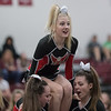 Madision Swisher prepares to ne hoisted up by her stunt group