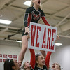 Madison Swisher takes the We Are sign from Carlee Huffman as they lead the fans in a cheer