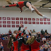 Carlee Huffman falls back to the mat to the waiting arms of her stunt group