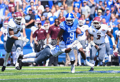 Kentucky's Garrett Johnson slips away from an Eastern Kentucky defender after a reception on Saturday.  MARTY CONLEY/ FOR THE DAILY INDEPENDENT
