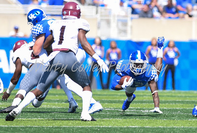 Kentucky's Sihiem King extends forward after getting tripped up against Eastern Kentucky on Saturday afternoon.  MARTY CONLEY/ FOR THE DAILY INDEPENDENT