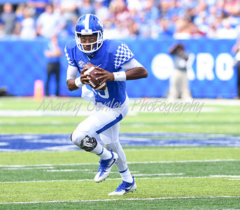 Kentucky quarterback, Stephen Johnson rolls to the outside to score a touchdown on Saturday against Eastern Kentucky.  MARTY CONLEY/ FOR THE DAILY INDEPENDENT