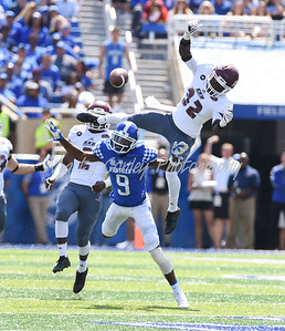Kentucky's Garrett Johnson is unsuccessful in pulling in the ball as Eastern Kentucky's Buck Solomon applies pressure on Saturday in Lexington.  MARTY CONLEY/ FOR THE DAILY INDEPENDENT