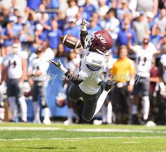 Eastern Kentucky's Buck Solomon makes an attempt pick off a Kentucky pass on Saturday in Lexington.  MARTY CONLEY/ FOR THE DAILY INDEPENDENT