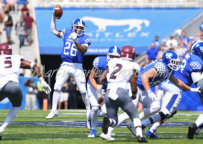 Kentucky's Benny Snell Jr. take a high snap on Saturday against Eastern Kentucky at Kroger Field in Lexington.  MARTY CONLEY/ FOR THE DAILY INDEPENDENT
