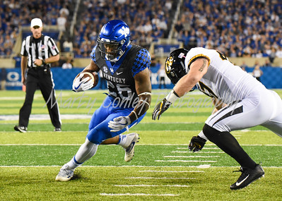 Benny Snell Jr. of Kentucky finds a running lane on Saturday evening against Missouri.  MARTY CONLEY/ FOR THE DAILY INDEPENDENT