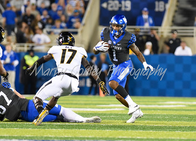Kentucky's Lynn Bowden, Jr. tries to get out of the path of Missouri's DeMarkus Acy on Saturday evening.  MARTY CONLEY/ FOR THE DAILY INDEPENDENT