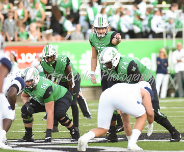 Marshall quarterback, Chase Litton shouts instructions on Saturday against Kent State in Huntington, WV.  MARTY CONLEY/ FOR THE DAILY INDEPENDENT