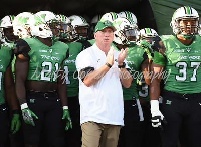 Marshall head coach, Doc Holliday prepares to take the field on Saturday against Kent State in Huntington, WV.  MARTY CONLEY/ FOR THE DAILY INDEPENDENT