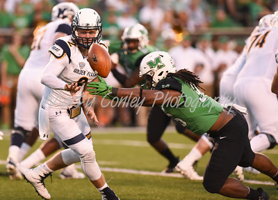 Kent State quarterback, George Bollas pitches the ball as Marshall's Davon Durant defends on Saturday evening.  MARTY CONLEY/ FOR THE DAILY INDEPENDENT