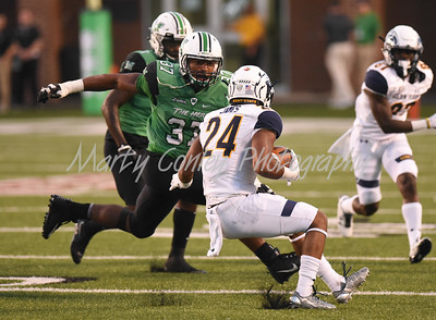 Kent State's Raekwon James looks for a lane as Marshall's Chase Hancock closes in.  MARTY CONLEY/ FOR THE DAILY INDEPENDENT