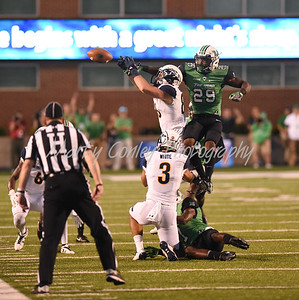 Marshall's Malik Gant breaks up a pass intended for Kent State's Conor Brumfield on Saturday evening in Huntington, WV.  MARTY CONLEY/ FOR THE DAILY INDEPENDENT